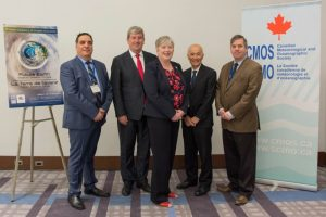 Photograph of five people taken at the opening ceremonies of the 51st annual CMOS congress. From left are M. Ron Bianhi, l'honorable Glen Murray, Mlle Bernadette Jordan, Prof. Roger Wakimoto and M. Martin Taillefer