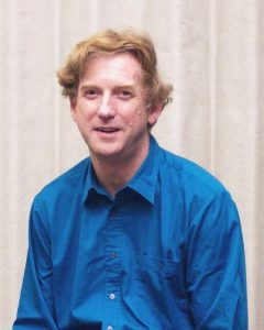 Photo of a clean shaven caucasian male in his 40's in a blue shirt, Jim Drummond PI of MOPITT