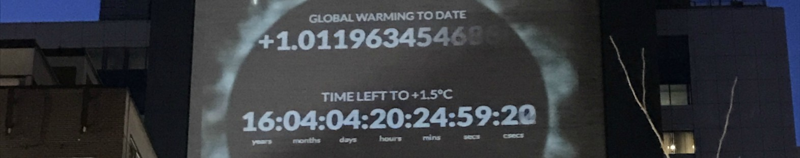 Image shows the climate clock projected on to the side of a building