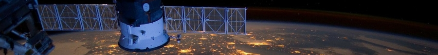 Photo shows a satellite in space, at night, with a view of land below studded with lights, for an update for CMOS members on the GWE conference.