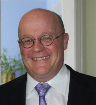 Michael Crowe, author of ArcRCC article, a middle aged bald man with glasses, smiling.