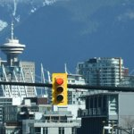 Vancouver skyline showing the tower and traffic lights with mountains in the background